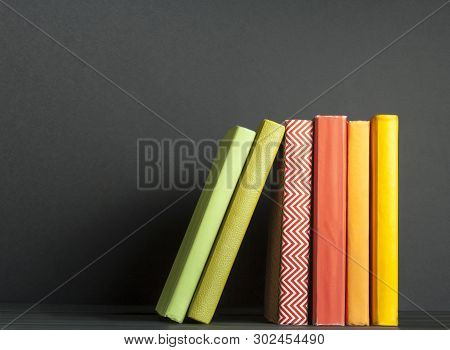 Row Of Colorful Books On The Wooden Table. Education Background. Back To School.copy Space For Text.