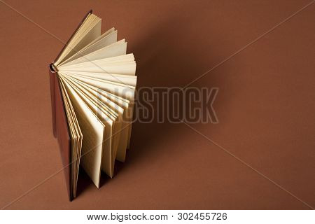 Open Book On Wooden Table. Education Background. Back To School.copy Space For Text.