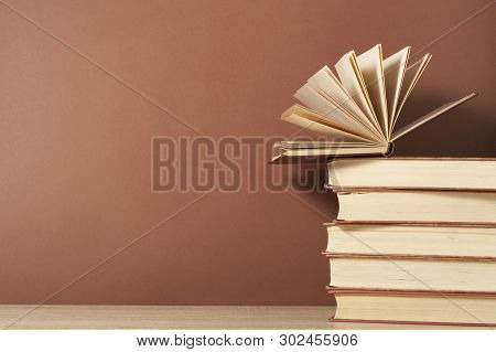 Open Book And Stack Of Books On Wooden Table. Education Background. Back To School.copy Space For Te