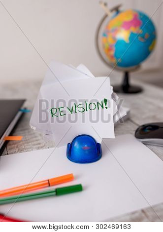 Word writing text Revision. Business concept for action of revising over someone like auditing or accounting Stationary and computer stuff plus pen with paper sheets on the wooden desk. poster