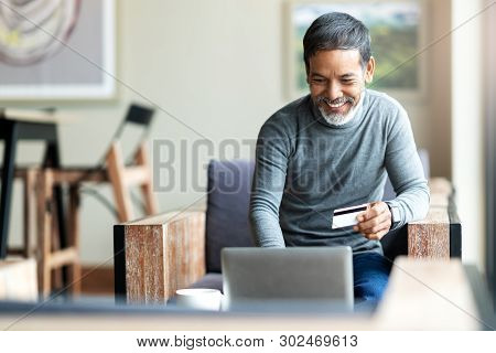 Attractive Bearded Hipster Asian Father Or Hispanic Old Man Using Laptop And Credit Card Payment Sho
