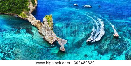 Fast Boat At The Sea In Bali, Indonesia. Aerial View Of Luxury Floating Boat On Transparent Turquois