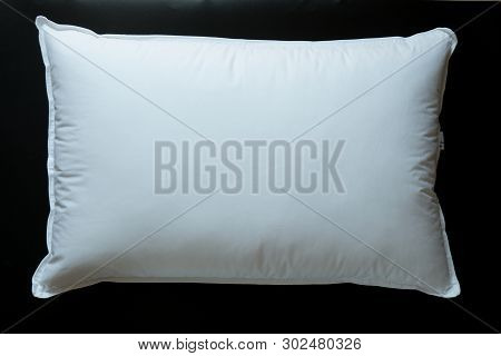Close-up Of White Pillow Isolated On A Black Background. Bed Dress, Pillow For Sleeping.