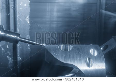 The 5-axis Cnc Milling Machine Cutting The Automotive Part With Ball Endmill. The Multi Axis Machini