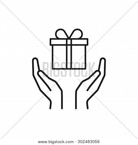 Black Isolated Outline Icon Of Gift Box In Open Hands On White Background. Line Icon Of Gift Box And