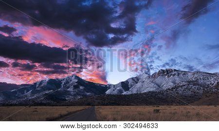 A Gorgeous Sunset Of Red And Blue Over A Snowy Mountain Horizon, Huachuca Mountains, Arizona, Usa