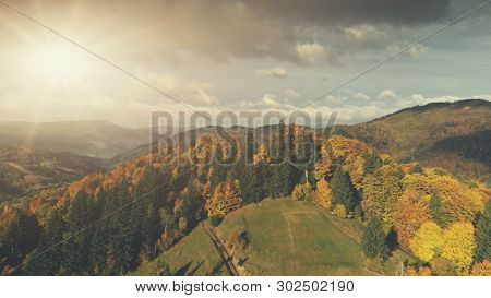 Carpathian Mountain Autumn Sunset Scenery Aerial View. Epic Wild Nature Forest Hill Landscape Country Road Overview. Majestic Panoramic Peak Scene Cloud Sky Holiday Concept Drone Flight Shot