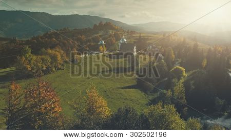 Sunset Mountain Village Church Scenery Aerial View. Panoramic Autumn Wild Nature Hill Landscape Overview. Rural High Meadow Unpolluted Environment, Tourism Concept