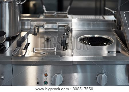 Work Surface And Kitchen Equipment In Professional Kitchen, View Counter In Stainless Steel.