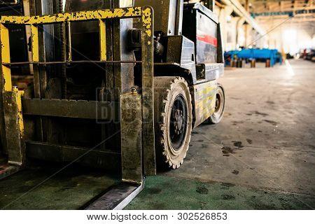 Closeup Old Forklift In The Manufacturer. Forklift In The Enterprise