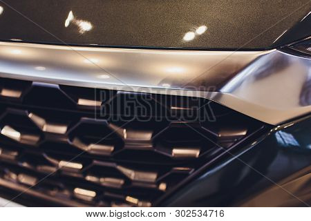 Grid Of Car With Sunflare. Radiator Grille. Metal Close-up Texture Background. Chrome Grill Of Big P