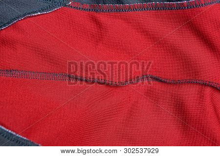 Red Gray Cloth Texture From A Crumpled Piece Of Fabric With A Seam