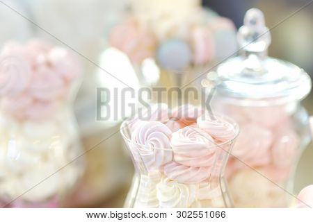 Delicious Fancy Fruit Pastils In Glass Jar. Beautiful Delicious Sweet Dessert On Blurred Background