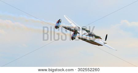 Pilsen / Czech Republic - September 9, 2018: Flying Bulls Red Bull sponsored Lockheed P-38 Lightning. Rare fighter plane over Pilsen.