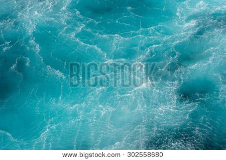 Turbulence flow of sea water happen by the helicopter hop over the water surface. poster