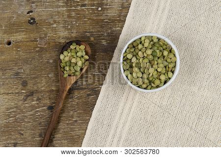 Dried Green Pea In Half, Minimally Processed Food In Rustic Background