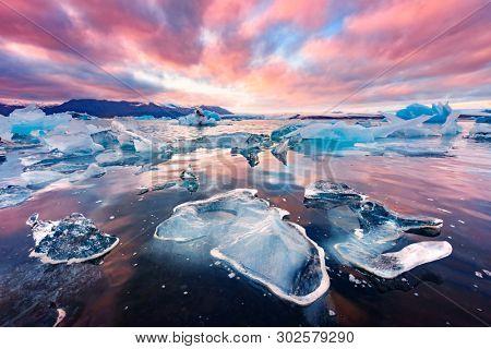 Incredible landscape with icebergs in Jokulsarlon glacial lagoon. Vatnajokull National Park, southeast Iceland, Europe.