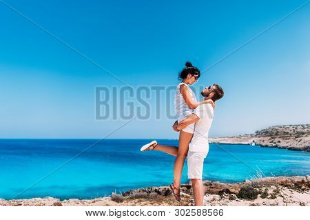 Happy Couple By The Sea. Man And Woman Having Fun On The Sea. Honeymoon Lovers. Man And Woman On The