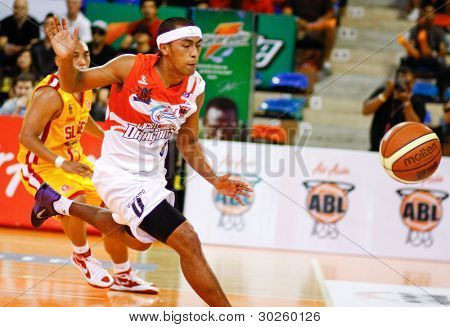 KUALA LUMPUR - FEBRUARY 19: Malaysian Dragons Guganeswaran (0) chases after a loose ball at the ASEAN Basketball League match against Slingers on February 19, 2012 in Kuala Lumpur. Dragons won 86-71.