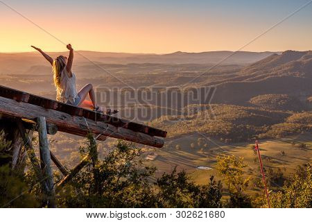 Woman On Timber Runway Pier Overlooking Beautiful Valley. Embrace Each Day, Love Life, Wellness, Lif