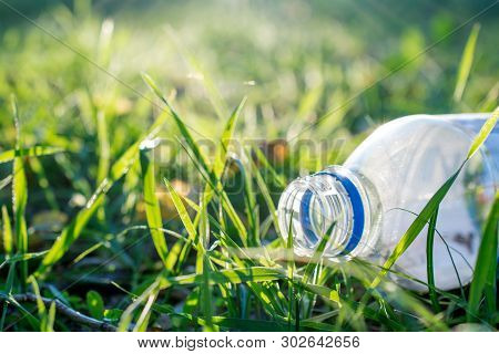 A Plastic Bottle Land Pollution. Pollution By Plastic Control, Beat Plastic Pollution Concept