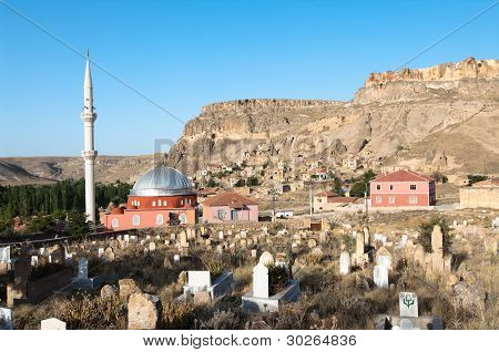 cemetery, mosque and the village of Yaprakhisar near the Ihlara valley in Cappadocia - Turkey poster