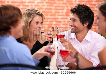 Four friends drinking in restaurant