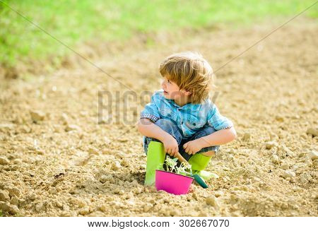 Organic Farm. Planet Protection. Small Kid Planting Flower. Ecology Life. Eco Farm. Human Nature. Ea