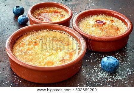 Creme Brulee (cream Brulee, Burnt Cream) In Terracota Cazuela Dishes On Old Baking Tray Decorated Wi