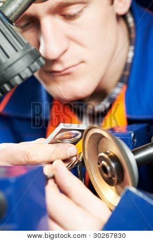 mechanical technician worker measuring detail tool after sharpening cutting machine center at workshop