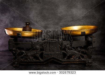 Antiquarian Scales With Two Golden Bowls And Old Weight