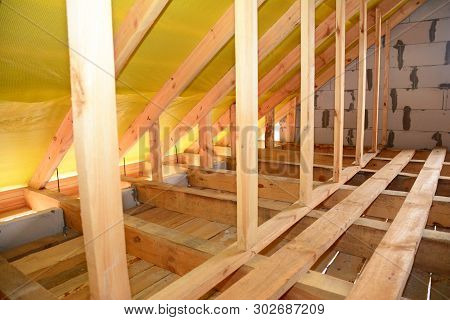 Roofing Construction Attic Interior. Wooden Roof Beams,  Frame House Attic Construction.
