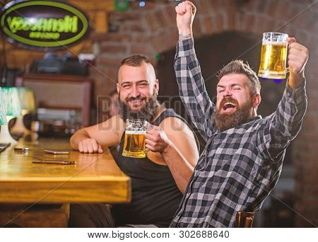 Refreshing Beer Concept. Hipster Brutal Man Drinking Beer With Friend At Bar Counter. Men Drunk Rela