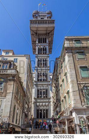 Lisbon, Portugal - April 14, 2018: Elevador de Santa Justa Lift seen from Santa Justa Street. 19th century. By Raul Mesnier de Ponsard, a Gustave Eiffel disciple.