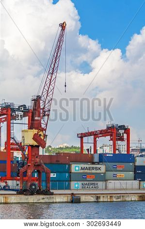 Lisbon, Portugal - November 05, 2018: Porto de Lisboa or International Port of Lisbon in the Tagus River. Cranes and shipping containers