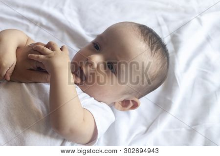 Baby Teething. Baby Tooth Care Concept. Mother Checking Her Baby Boy Mouth. First Signs Of Baby Teet