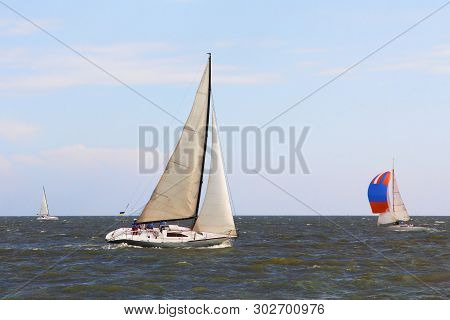 Sailing Boat Yachts At Sea Blue Sky Background. Round The Cans Race.