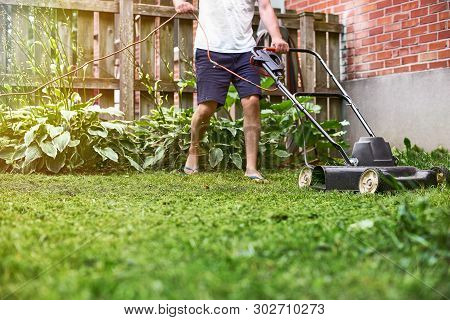 The Lawn Mower Is Old In A Private House, Mowing The Grass, Appliances, Mowing, Gardener, Care, Work