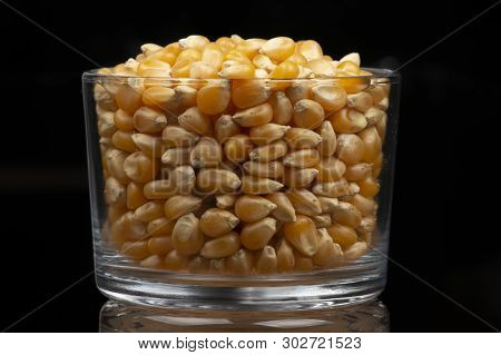 Corn Popcorn In Glass Pot With Black Background