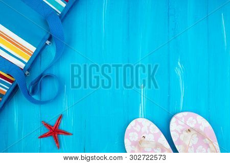 Straw Hat, Sunglasses And Beach Slippers, Summer Bag On Wood , Summer Background. Top View.