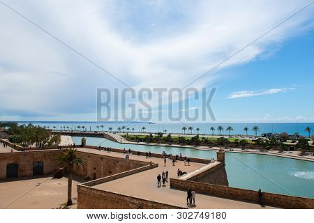 Panoramic view from La Seu, the gothic medieval cathedral of Palma de Mallorca, Spain. Beautiful landscape with ancient walls, sky and Mediterranean sea
