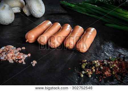 Small Row Of Long Sausages, Onion And Mushrooms