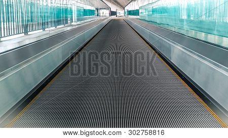 Modern Walkway Of Escalator Move Forward And Escalator Move Backward In International Airport. Escal