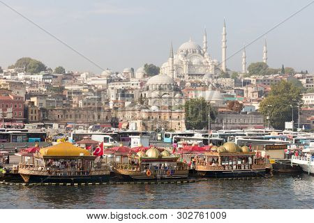 Istanbul, Turkey - September 21st 2015: Snack Boats And The Suleiman Mosque. The Vendors On The Boat