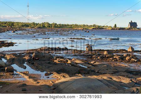 Village Of Rabocheostrovsk, Kem. White Sea At Low Tide. Kemsky District, Republic Of Karelia, Russia