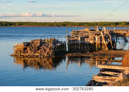 Old Ruined Jetty. Village Of Rabocheostrovsk. White Sea, Kemsky District, Republic Of Karelia, Russi