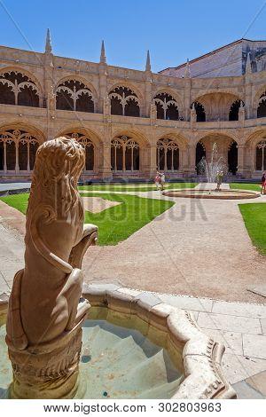 Lisbon, Portugal - June 30, 2018: Lion fountain. Cloister of Jeronimos Monastery or Abbey aka Santa Maria de Belem. UNESCO World Heritage. Manuelino or Manueline