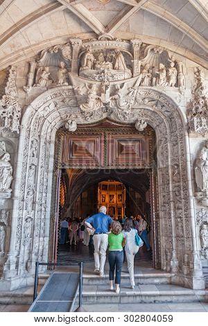Lisbon, Portugal - June 30, 2018: West Portal of the Jeronimos Monastery or Abbey aka Santa Maria de Belem. UNESCO World Heritage Site. Manuelino or Manueline art.