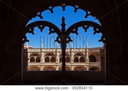 Lisbon, Portugal - June 30, 2018: Detail of the cloister of the Jeronimos Monastery or Abbey aka Santa Maria de Belem monastery. UNESCO World Heritage. Manuelino or Manueline