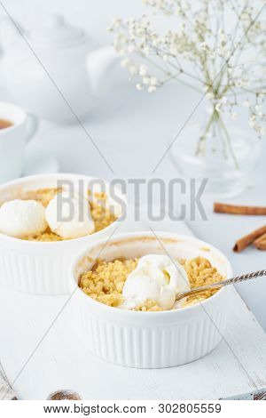 Apple Crumble With Streusel On Light Gray Table. Vertical. Morning Breakfast.